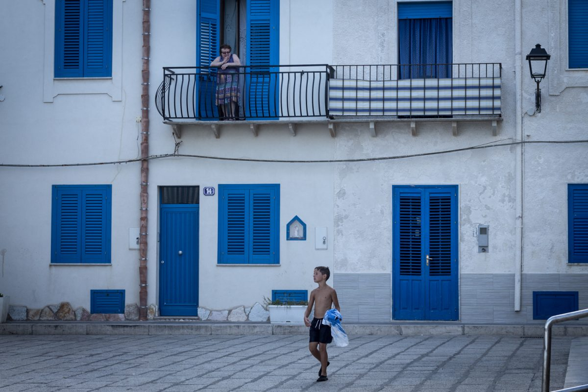 child in front of an house